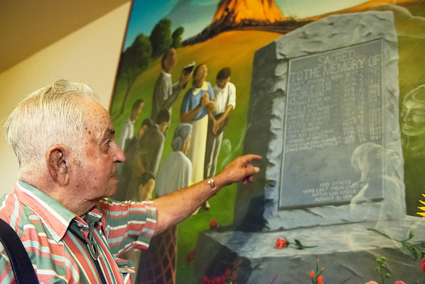 Globe/Roger Nomer<br /> Wayne Johnson points out his grandfather's name in Anthony Benton Gude's mural of the Tipton Ford train wreck at the Neosho United Methodist Church on Thursday.
