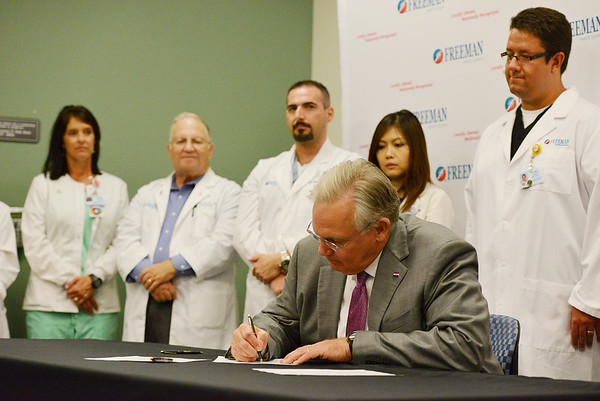 Globe/Roger Nomer<br /> Gov. Jay Nixon signs Senate Bill 639, which relates to breast density, at Freeman Hospital on Tuesday.