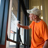 Globe/Roger Nomer<br /> Michael Williams washes windows at the Joplin Police Department on Thursday.