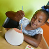 Globe/Roger Nomer<br /> Jada Smith, 7, Joplin, paints a bowl at Firehouse Pottery in Joplin on Thursday afternoon.