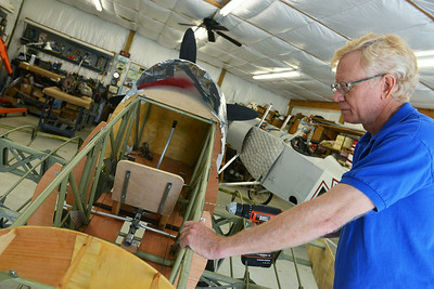 Globe/Roger Nomer Darryl Coit works on a replica Douglas Dauntless SBD-5, which will be eventually included in the Freedom of Flight Museum.
