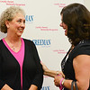 Globe/Roger Nomer<br /> Kathy Brown, left, talks with Kristi Seibert, outreach director for the Breast Cancer Foundation of the Ozarks, following Tuesday's signing of breast density legislation at Freeman Hospital.