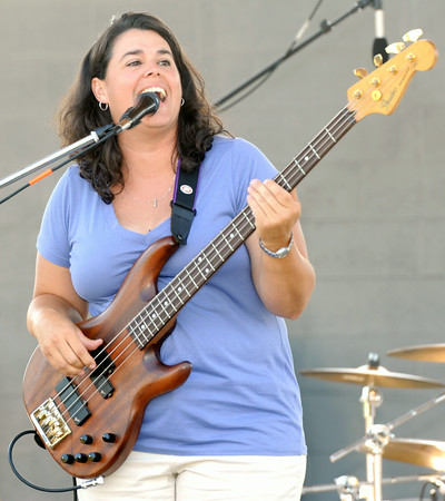 Leah Ingram, singer for the band Diversity, entertains the crowd at the Independence day celebration on Friday at Landreth Park.<br /> Globe | Laurie Sisk