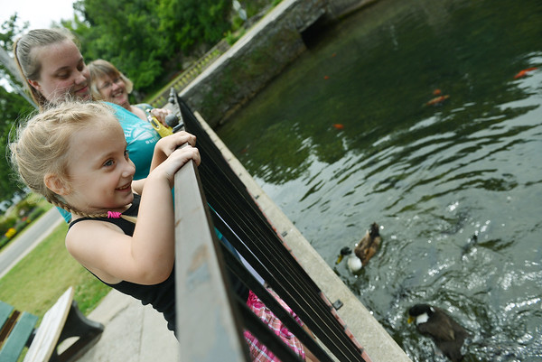 Globe/Roger Nomer<br /> Elexis Jessen, 4, laughs as she feeds the ducks at Big Spring Park in Neosho with her mother Jessica, middle, and grandmother Susan Overstreet on Wednesday afternoon.