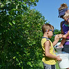 Globe/Roger Nomer<br /> Connor, 6, and Elise, 2, Beck help their mother Rebecca, Oronogo, pick blueberries at Heritage Family Farms on Wednesday morning.