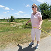 Mariann Jackson, a Riverton resident and opponent of a proposed landfill in Riverton, uses a tape measure to determine the distance of the site from Highway 69 on Tuesday.<br /> Globe | Laurie Sisk