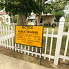 A Notice of Public Hearing sign sits in the front of Janet Garvin's Lustron home on Wednesday.<br /> Globe | Laurie Sisk