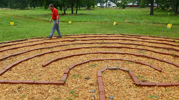 Globe/Roger Nomer<br /> Allan Schultz, building and grounds chairman at Peace Lutheran Church, walks the labyrinth on the church grounds on Thursday morning.