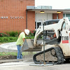 Crews continue working Monday on construction of a circle drive at Kelsey Norman.<br /> Globe | Laurie Sisk