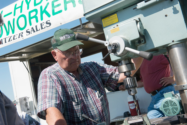 Globe/Roger Nomer<br /> John Pitzer, with Venture Equipment in Glenwood, Iowa, demonstrates a drill press on Friday at the Four State Farm Show.