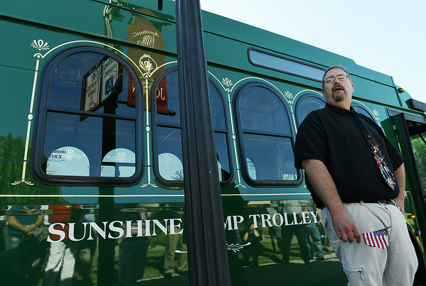 Globe/Roger Nomer<br /> Robert Lolley, Joplin transit coordinator, introduces the new Sunshine Lamp Trolley during a ribbon cutting at the Joplin Public Library on Friday.