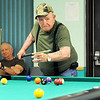 Don Gilleland watches his shot roll toward the hole as Richard Bible waits his turn on one of four pool tables at the Joplin Senior Center on Friday morning. <br /> Globe | Laurie Sisk