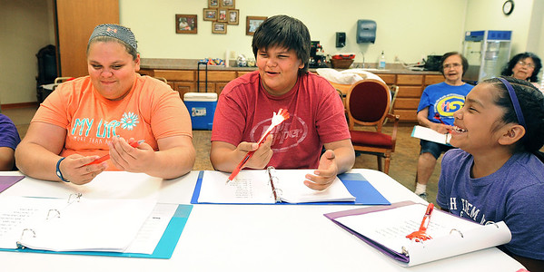 From the left: Fifteen-year-old Twins Christina and Raymond Sharp and Kinzhee Yazzie, 10, practice counting to 10 in Quapaw language during the Quapaw Tribal Youth Language and Cultural Preservation Camp on Wednesday at the Quapaw Tribal Museum.<br /> Globe | Laurie Sisk