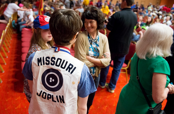 Globe/Roger Nomer<br /> Eliza Smith, 19, wore her father's shooting jacket from the 1975 championship during the 50th Annual Daisy National BB Gun Championship in Rogers, Ark., on Friday evening. Members of the Joplin team that won the first championship 50 years ago were honored during the opening ceremonies.