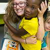 """Seven-year-old Zurrhia Hester hugs her self-proclaimed """"bestie,"""" Boys and Girls Club volunteer Lizzy Smith, on Friday at the club during storytime.<br /> Globe 