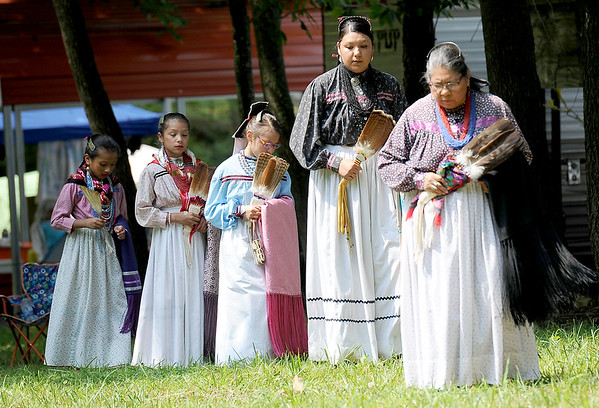 From the left: Sharla Wilson-Gabales, Tahnee Stands, Leatha James, Patience Smith and Kaylyn Smith perform the Turkey Dance on Saturday morning at the Quapaw Pow Wow in Quapaw, Okla.<br /> Globe | Laurie Sisk