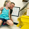 Six-year-old beekeeper Lila Cade looks at one of her bee hives with her father, Ben Cade, before Lila's presentation on beekeeping on Wednesday morning at Missouri Southern State College.<br /> Globe | Laurie Sisk