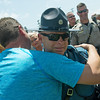 Globe/Roger Nomer<br /> Missouri Highway Patrol Master Sgt. Bruce Klier gets a hug of support from Jay Boice, Neosho, on Sunday at a rally to support law enforcement officers at the Lampo Building in Neosho.