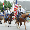Members of the Jasper County Sheriff's Posse bring up the rear during the Fourth of July Parade in downtown Carl Junction on Monday.<br /> Globe | Laurie Sisk