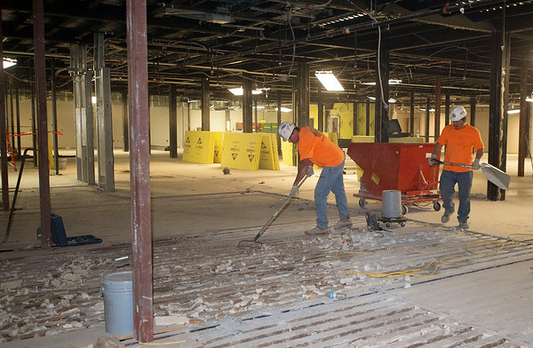 Workers clean up debris Wednesday from interior demolition inside the new Kansas City University of Medicine and Biosciences, which is slated to open next summer.<br /> Globe | Laurie Sisk