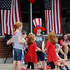 Spectators adorned in red, white and blue await the start of the Fourth of July Parade in downtown Carl Junction on Monday.<br /> Globe | Laurie Sisk