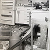A photograph of damage to a house about a mile from the 1966 Hercules explosion shows a piece of truck, lower left, that ended up in the kitchen.<br /> Courtesy photo/Sharon McNew-Kinman.