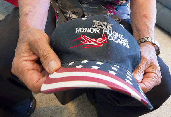 Korean veteran Edwin Patron holds a hat from one of the two honor flights he has taken. Patron lives with caretaker Tom Jones and Jennifer Jones on their rural Verona farm as part of a VA program that matches veterans with caretakers.<br /> Globe | Laurie Sisk