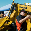 Globe/Roger Nomer<br /> Victor Hood, with Garfield Equipment in Enid, Okla., talks with a customer on Friday at the Four State Farm Show.