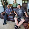 Korean War veteran Edwin Patron, left,  sits with his caretaker Tom Jones and Jennifer Jones on Friday at the Jones' rural Verona home. Patron lives with caretaker Tom Jones and Jennifer Jones on their Verona farm as part of a VA program that matches veterans with caretakers.<br /> Globe | Laurie Sisk