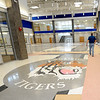 A worker walks past the partially masked logo inside the front entrance of Carthage R-9's new intermediate school on Thursday.<br /> Globe | Laurie Sisk