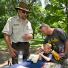 Four-year-old Silas Rogers and his father, Joey Rogers, both of Neosho, check out a model of a skull of an alligator snapping turtle as Bruce Hallman, education specialist at the Neosho National Fish Hatchery, looks on during the Carver Day Celebration at Carver National Monument on Saturday.<br /> Globe | Laurie Sisk