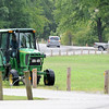 Crews mow inside Wildcat Park on Wednesday morning. The park will soon be celebrating its 100th anniversary.<br /> Globe | Laurie Sisk