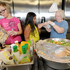 From the left: Volunteers Izzy Bittick, 11, Ruby Portillo, 9 and head cook Terry John prepare to serve an afternoon on Wednesday at Feeding Inc. in Carthage. Since transitioning from the former River Street Pantry, Feeding Inc. has expanded its programs to include language classes and teaching workplace skills, while feeding about 2.000 people per month.<br /> Globe | Laurie Sisk
