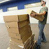 Kelby Robbins, of G and A Tech, moves supplies inside the media room at Carthage R-9's new intermediate school on Thursday.<br /> Globe | Laurie Sisk