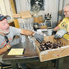 From the left: Joplin Workshop, Inc. employees Jimmie Martin and Jack Dutton assemble Whoa-Stops, used in the hydraulic components of machinery, such as John Deere tractors, at the manufacturing workshop on Tuesday afternoon.<br /> Globe | Laurie Sisk