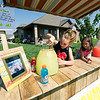 From the left: Ten-year-old Drew Yockey stirs a fresh batch of lemonade as Mirabella Moore, 6, looks on at their lemonade stand on Indiana Avenue on Wednesday afternoon. The pair are trying to raise money for Yockey's teacher, Amanda Sharp, who is battling heart cancer.<br /> Globe | Laurie Sisk