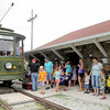 Passengers await their turn to ride Streetcar No. 60 on Thursday at the Webb City Farmers Market.<br /> Globe | Laurie Sisk