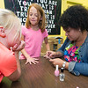 Boys and Girls Club of Southwest Missouri mentor Dola Flake, right, helps nine-year-olds Joscelyn LaRue, left and Jesslynn Ugalde, center, with their nails on Friday at the club.<br /> Globe | Laurie Sisk