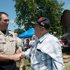 Globe/Roger Nomer<br /> Jasper County Sheriff Sgt. Craig Davis talks with Jim Jordan, Neosho, on Sunday at a rally to support law enforcement officers at the Lampo Building in Neosho.