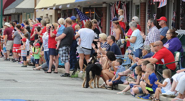 A large crowd watches during the Fourth of July Parade in downtown Carl Junction on Monday.<br /> Globe | Laurie Sisk
