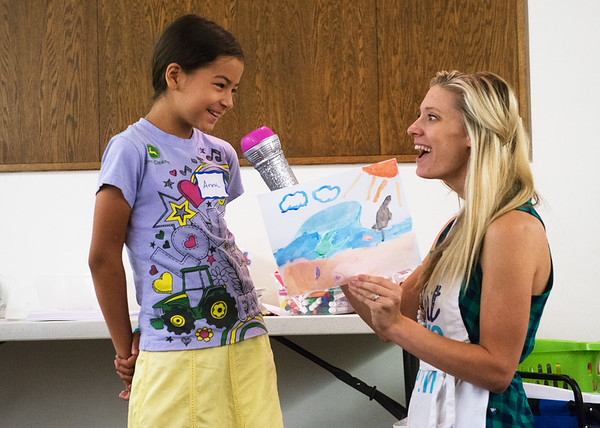 Globe/Roger Nomer<br /> Brianna Combs interviews Anna Roffaman, 10, about her drawing of her creative space on Friday during Art Feeds Creative Authors workshop at the Joplin Public Library. The Library will host an Art Feeds workshop every Friday in the month of July.