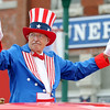 Uncle Sam waves to the crowd during the Fourth of July Parade in downtown Carl Junction on Monday.<br /> Globe | Laurie Sisk