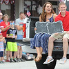 "Miranda Stafford, left and Kaleb Smith celebrate their engagement from the back of a truck just seconds after Smith proposed to Stafford in the middle of the Fourth of July Parade in downtown Carl Juntion on Monday. The truck bore a sign on the tailgate reading ""Miranda will you marry me?""<br /> Globe 