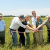 Members of the Missouri Prairie Foundation, the Missouri Department of Natural Resources, and the National Park Service cut the ribbon during a dedication of Carver Prairie on Saturday southeast of Joplin.<br /> Globe | Laurie Sisk