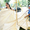 From the left: Ally De Los Santos and Elvira Garcia, of Weiser Tent Services in Monett, help set up one of about 200 tents in preparation for Marian Days, which begin Aug 4 in Carthage.<br /> Globe | Laurie Sisk