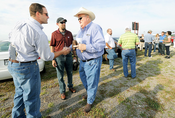 From the left: Missouri State University Coordinator of Business Management for the William H. Darr School of Agriculture Jeff Gettys and Assistant Professor of Plant Science Will McClain greet U.S. Rep. Billy Long at the start of the 2016 7th District Agriculuture Tour on Friday at the Joplin Regional Stockyards.<br /> Globe | Laurie Sisk