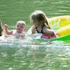 Four-year-old Addyson Fish, right, makes a new friend in eight-month-old Izelle Gillen while cooling off on Tuesday afternoon at Shoal Creek near McIndoe Park. Also pictured, left is Izelle's father, Sebastian Gillen.<br /> Globe | Laurie Sisk