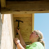 Globe/Roger Nomer<br /> Whitney Veldheer, 18, Grand Rapids, Mich., works on a house on Kentucky as she volunteers on Wednesday with World Renew Disaster Response Services.
