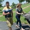 Globe/Roger Nomer<br /> Tyler Eden plays Pokemon Go as he walks with his wife Laurissa and son Greyson, 11 months, on Tuesday at Cunningham Park.