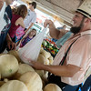 Globe/Roger Nomer<br /> Owen Detweiler, Lamar, sells canteloupe on Tuesday at the Webb City Farmers Market.